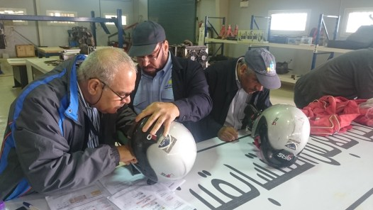 Checking helmet specifications at the Ha'il Rally