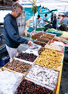 Lower sells his organic dates to urbanites at San Francisco's Farmer's Market.