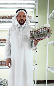 Abdullatif Alkhateeb, director of the Date Palm Research Center in al-Hasa, holds in vitro seedlings that will bear fruit 30 percent more quickly than traditionally grown palm offshoots.