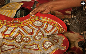 Ornamental leatherwork adorns what will become a usaada, or cushion. In the past, women used the same skills to decorate the leather bindings for manuscripts that are preserved in Tichit's libraries.