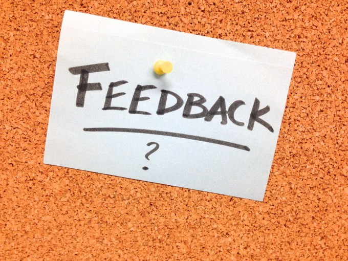 photo of notecard pinned to corkboard with the word feedback written on it