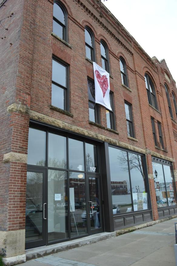 With a crew led by Save CR Heritage member Vaclav Hasek, heart banners were displayed on CSPS hall and other historic buildings in New Bohemia during the Preservation Showcase on Saturday, May 4, 2013. (photo/Cindy Hadish)