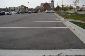 Numerous vacant spots can be seen at midafternoon Tuesday, Oct. 29, 2013, in the parking lot where First Christian Church was formerly located on Third Avenue SE in the Cedar Rapids medical district. (photo/Cindy Hadish)