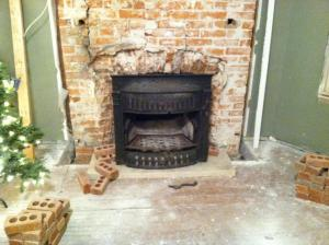 This fireplace was restored, while another had to be rebuilt. (photo/Mark Cardis)