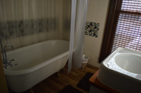Period items, such as clawfoot tubs, were found to bring back the home's original character. (photo/Cindy Hadish)