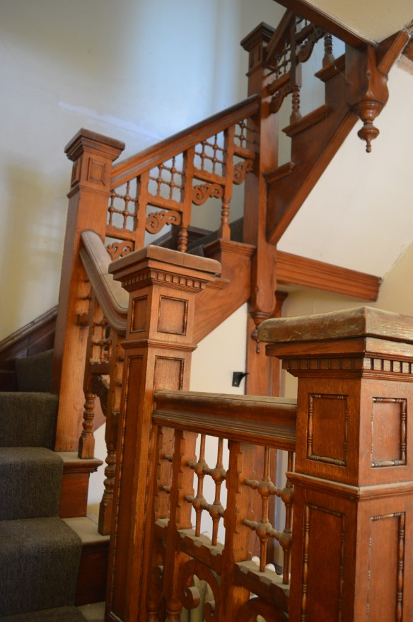 A grand staircase is one of the prominent features of the home, designed by architect Charles Dieman. (photo/Cindy Hadish)
