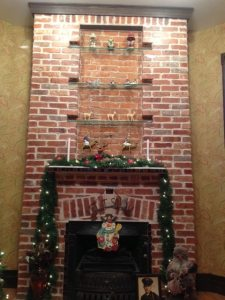 This shows the original fireplace after it was restored. (photo/Mark Cardis)