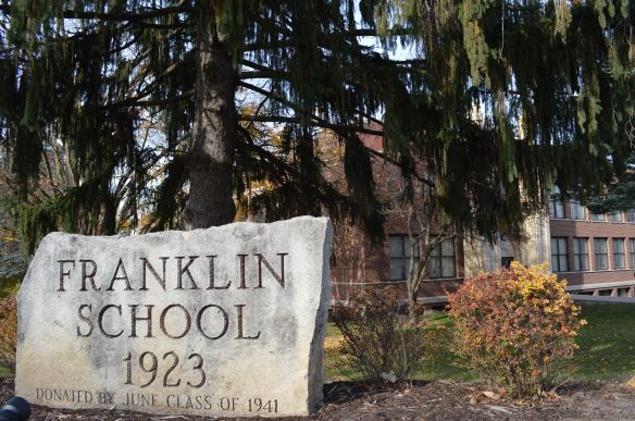 "Franklin Middle School, at B Avenue and 20th Street NE, bookends the new B Avenue NE Historic District, along with the more modern Polk Elementary School at the other end. Franklin is considered a ""contributing"" structure while Polk is not. (photo/Cindy Hadish)"