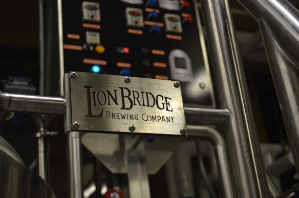 A Lion's Bridge sign marks an area under the control panel of the brewhouse in the former Fritz's Food Market in Cedar Rapids. (photo/Cindy Hadish)