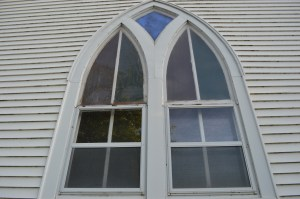 The church includes six Gothic windows, inset with colored glass. The owner is open to having the building moved or salvaged. (photo/Cindy Hadish)