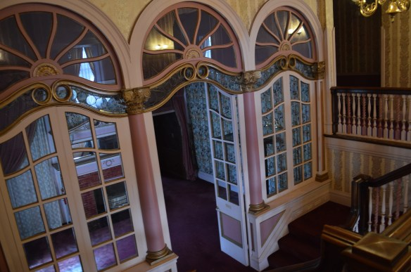 Interior doors lead to a mezzanine in the mansion, which had been used as a music room. (photo/Cindy Hadish)