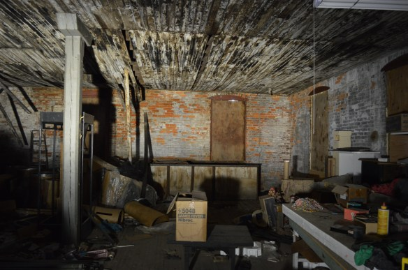 Little work has been done inside the Knutson Building since the site was flooded in 2008. (photo/Cindy Hadish)