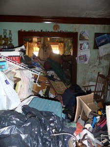 This photo, from the Affordable Housing Network, shows the living room inside the house before it was restored.