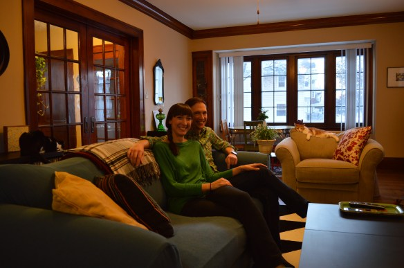 Liz Martin and Nathan Biehl are shown in the living room of their home in Wellington Heights. The house was rehabilitated through an Affordable Housing Network program. (photo/Cindy Hadish)