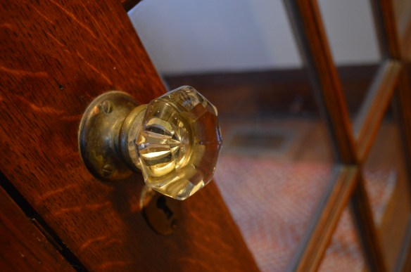 Glass doorknobs are among many original features retained in the home, which was built in 1919. (photo/Cindy Hadish)