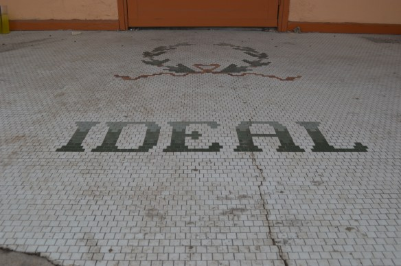 The name of the Ideal Theatre remains in tiles at the front of the building in Cedar Rapids. (photo/Cindy Hadish)