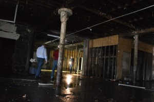 Potential developers were greeted by stench and a wet basement in touring the city-owned Knutson Building last summer. (photo/Cindy Hadish)