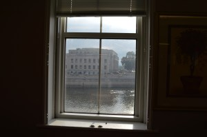 One side of the Smulekoff's building offers a view of the Linn County Courthouse and Cedar River in Cedar Rapids. (photo/Cindy Hadish)