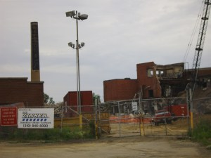 The Sinclair smokestack is seen in Cedar Rapids before its demolition in 2010. (photo/Cindy Hadish)