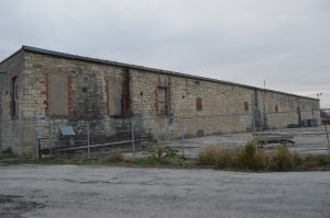 The stone warehouse at the former Sinclair meatpacking plant is one of the largest stone buildings remaining in Cedar Rapids. (photo/Cindy Hadish)