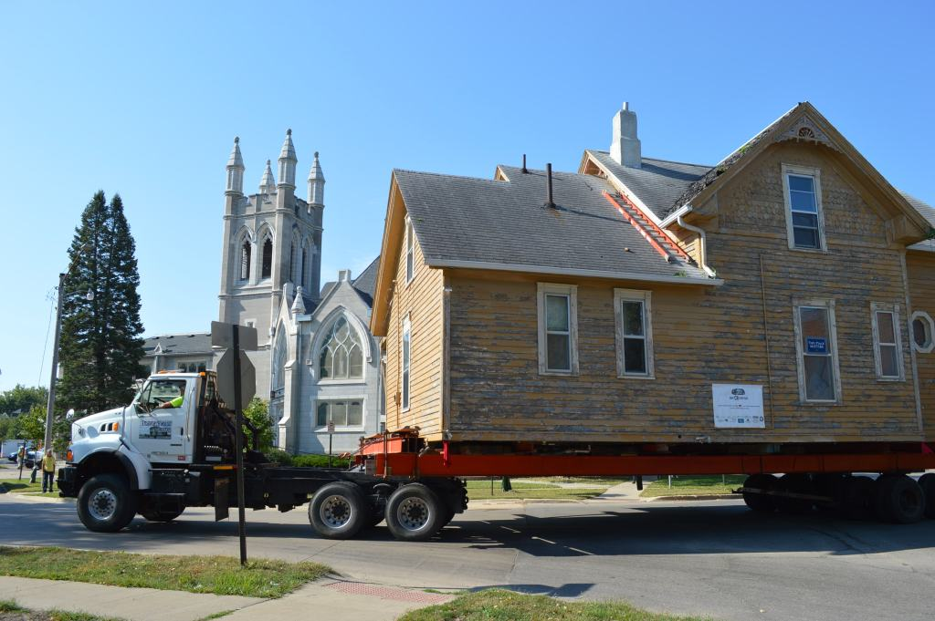 The Frankie House is shown rolling past Westminster Presbyterian Church during its move in September 2015 to a new site just blocks away in Cedar Rapids. (photo/Cindy Hadish)