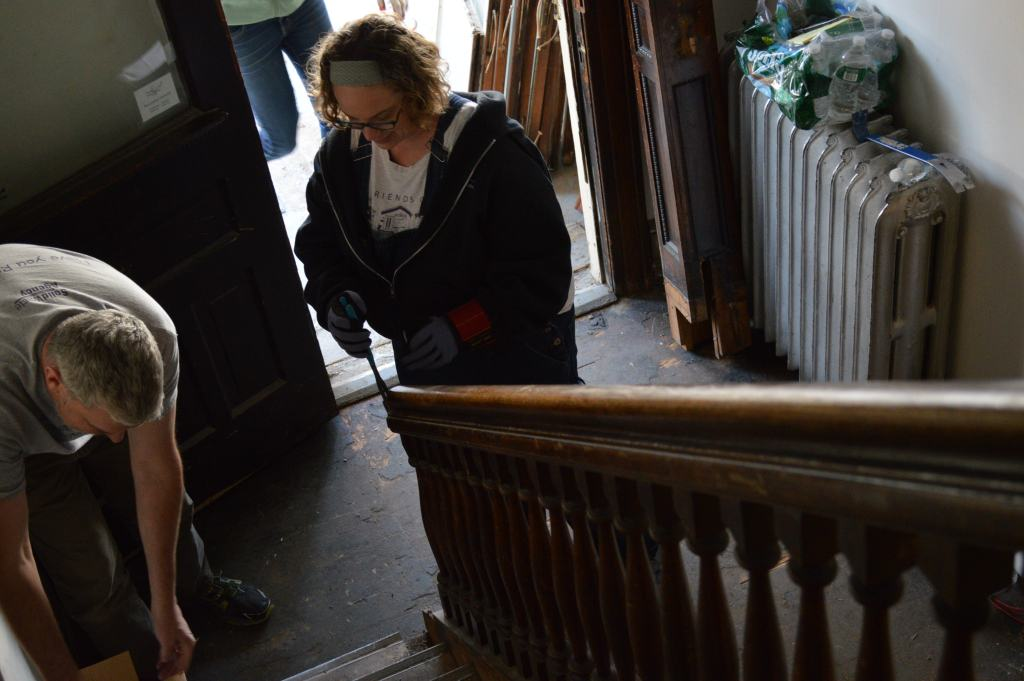 Save CR Heritage board member Lance LeTellier and Alicia Trimble, executive director of Friends of Historic Preservation, prepare to remove the staircase railing at the Women's Resource and Action Center in Iowa City on Tuesday, March 29, 2016. (photo/Cindy Hadish)