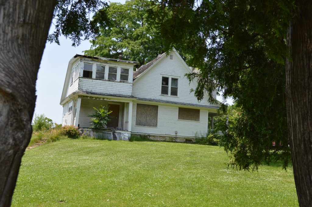 The former caretaker's house at Oak Hill Cemetery in Cedar Rapids, listed on the National Register of Historic Places, will soon be demolished. (photo/Cindy Hadish)