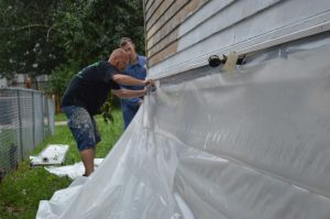 Scott Beck of Beck's Painting prepares the site for paint removal. (photo/Cindy Hadish)