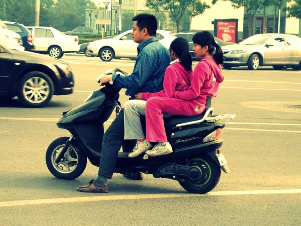 Beijing-China-Photograph-Kids-No-Helmets-Traffic-Motorcycle