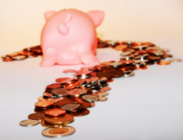 stock-photo-money-cash-piggy-bank-trail-coins