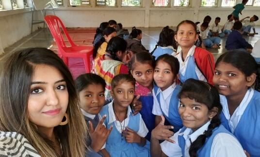Saville employee volunteering at a school