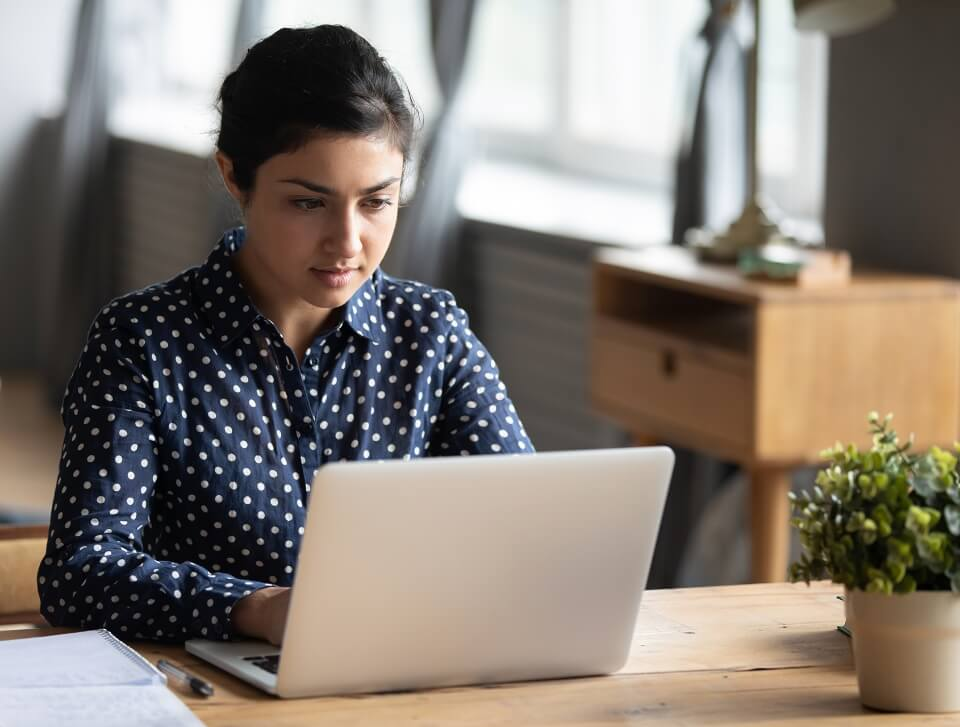 woman at home working on a laptop