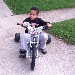 Case riding a tricycle
