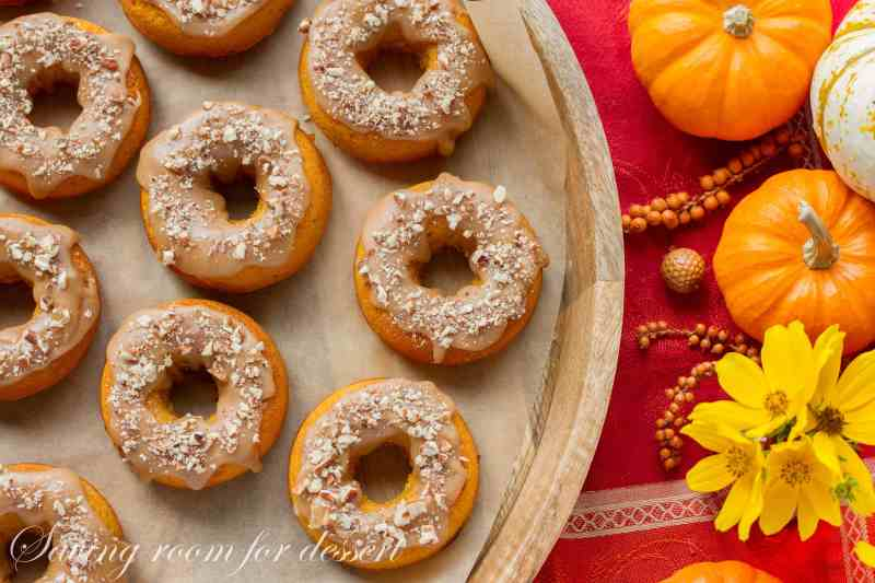 Pumpkin Donuts with Caramel Icing and Toasted Pecans | www.savingdessert.com