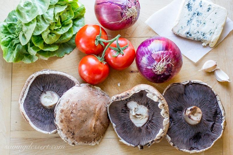 lettuce, onions, tomatoes, blue cheese and portobello mushrooms