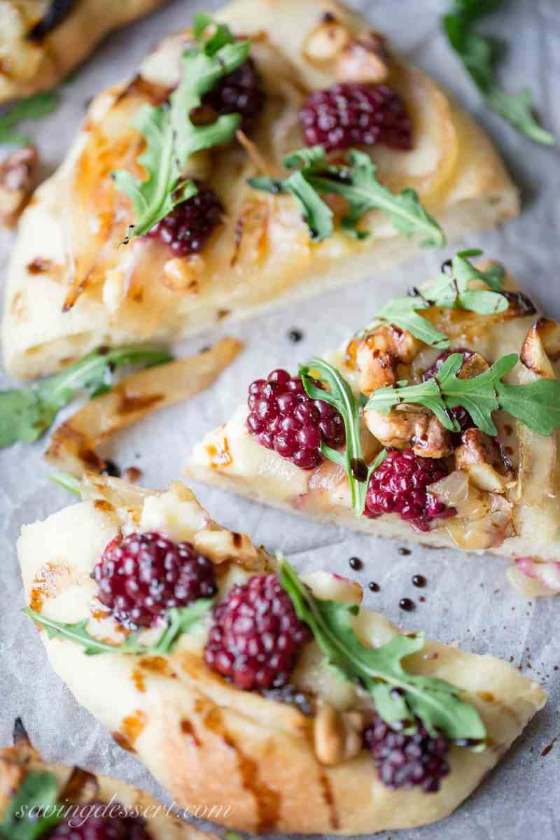 Blackberries and brie mini pizzas with onions and balsamic