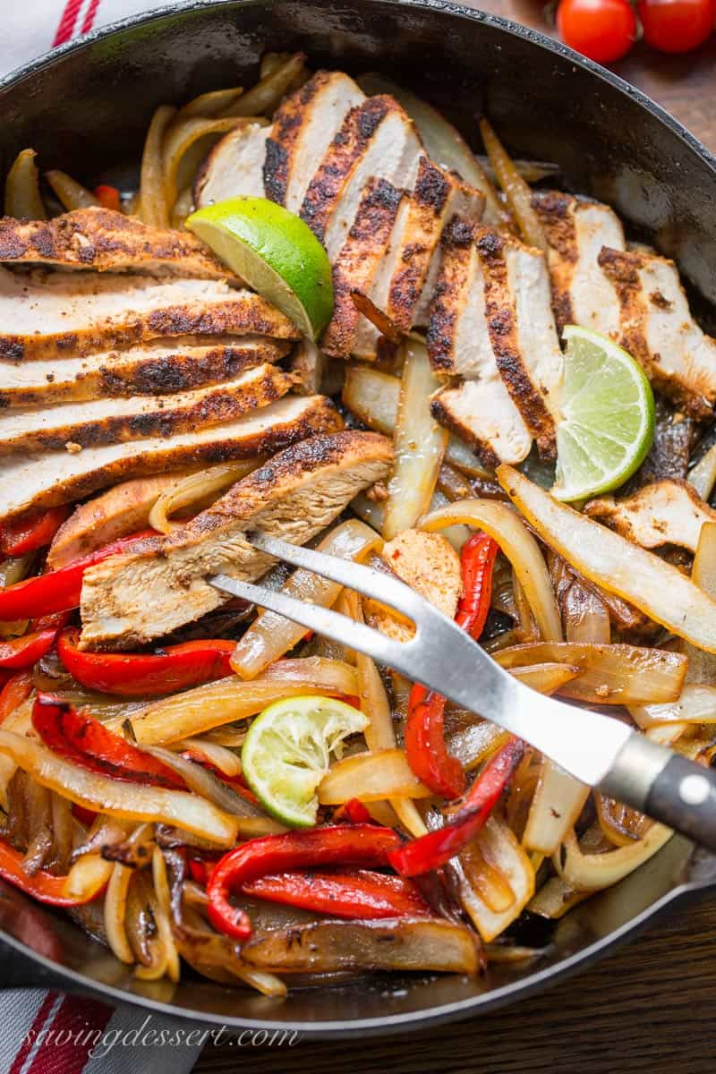 Skillet chicken fajitas with peppers, onions and lime