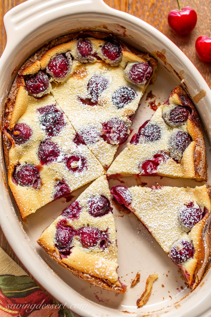 A casserole pan with cherry almond Clafoutis