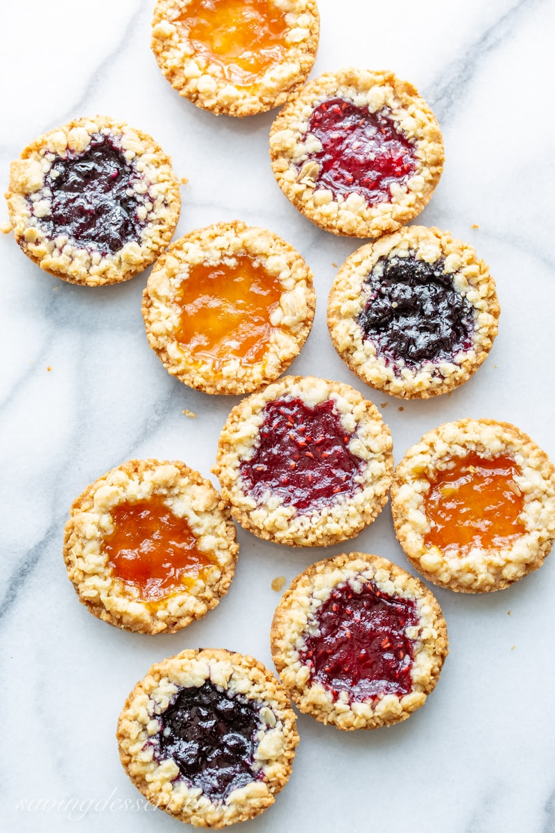 Oatmeal Jammy cookies filled with blueberry, apricot and raspberry jam with a streusel topping around the edges
