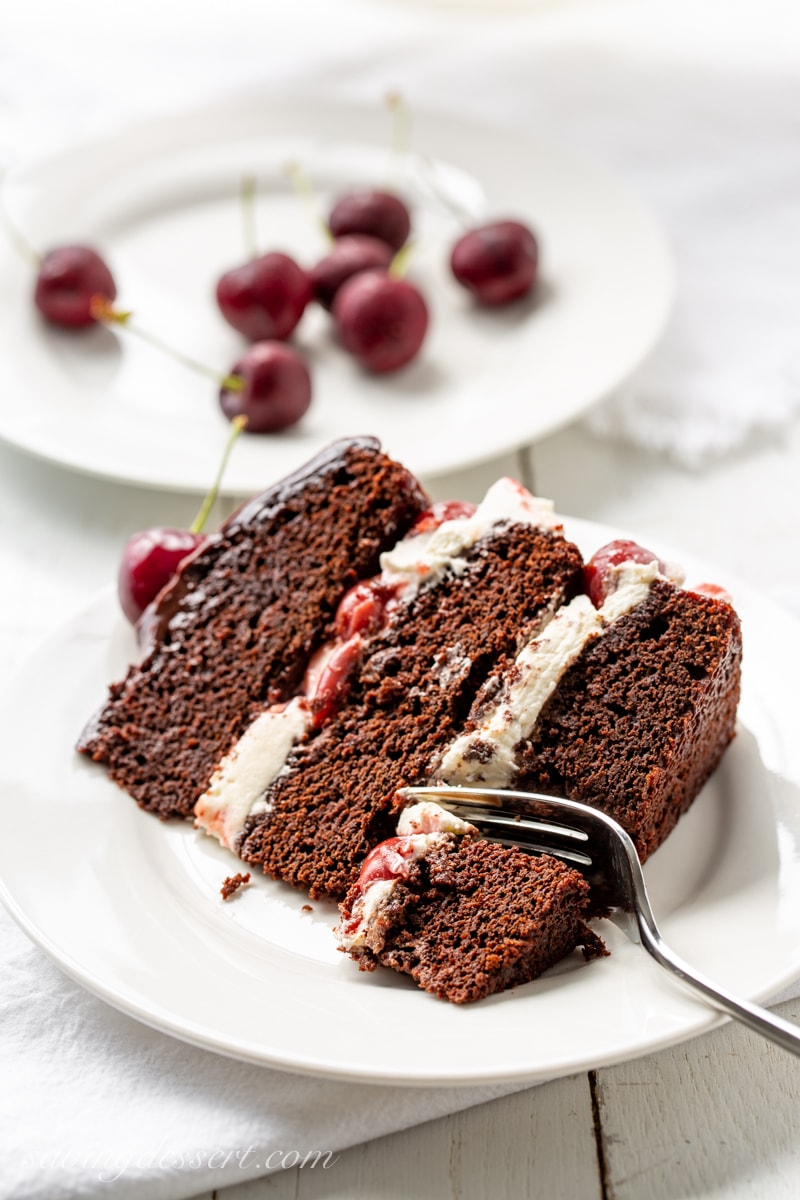 A slice of Black Forest Cake with whipped cream filling