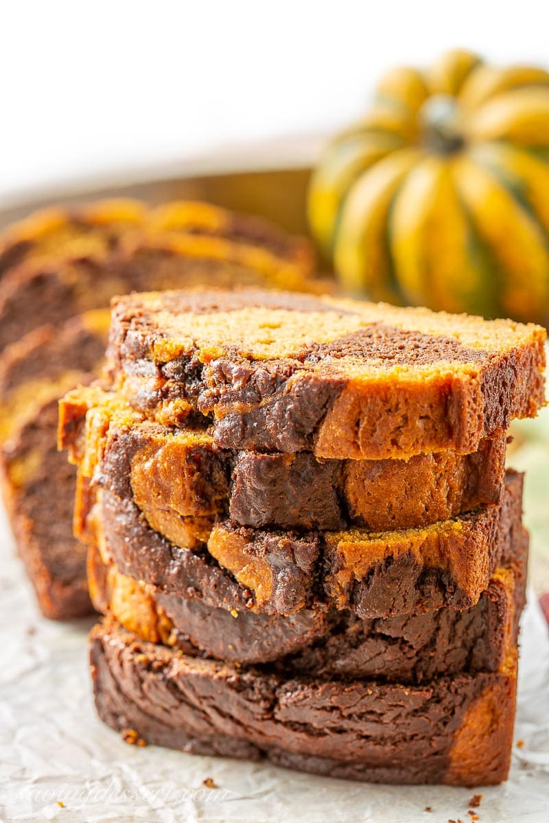 A stack of sliced chocolate marbled pumpkin bread