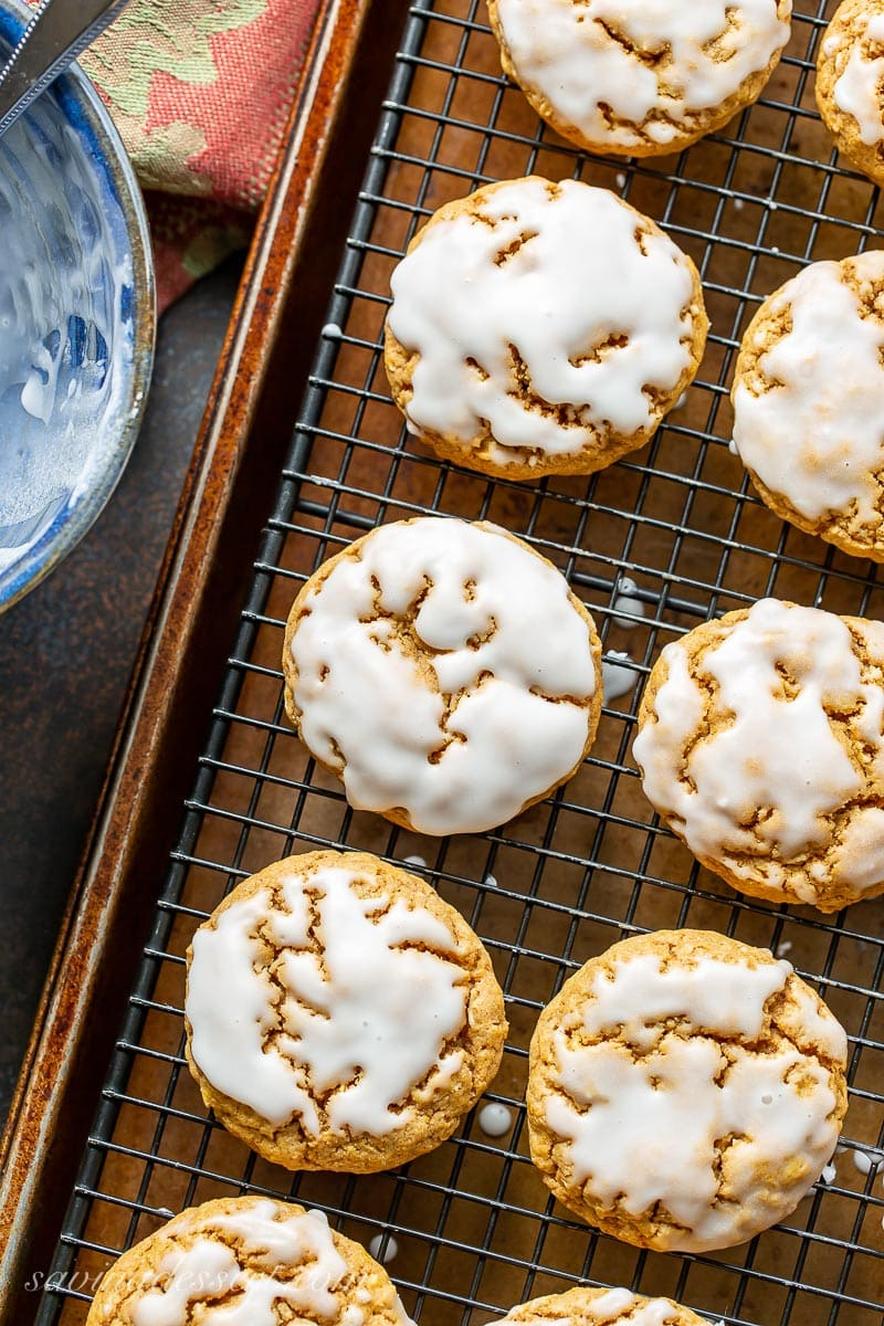 A cooling rack with iced pumpkin oatmeal cookies