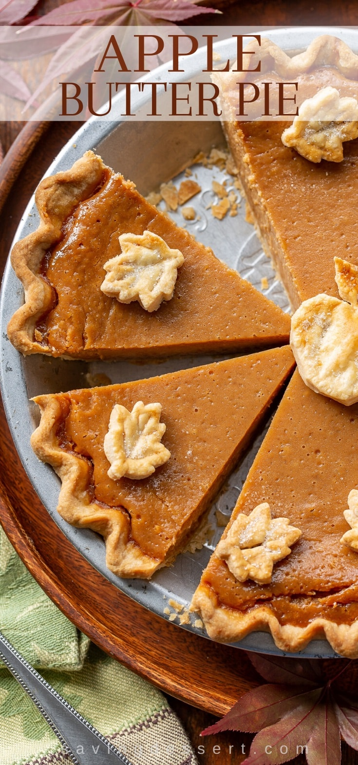 Sliced apple butter pie decorated with pastry cut-outs