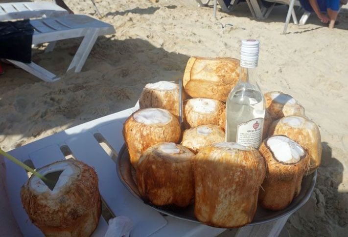 Who can resist a rum-filled coconut on the beach?