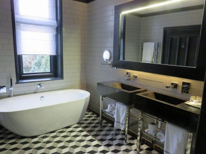 The beautiful bathrooms include specially-made 3-D flooring and high-end amenities.