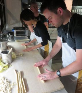 Rolling out the gnocchi dough to form delicious morsels.