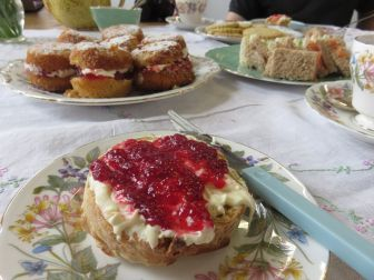 Scones dressed Devon style, with the jam on top of the cream.