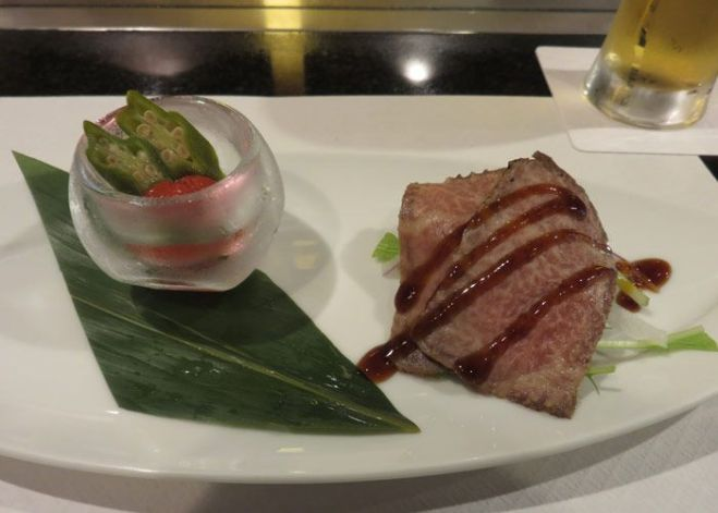 Kobe beef appetizer with tomato and pickle salad