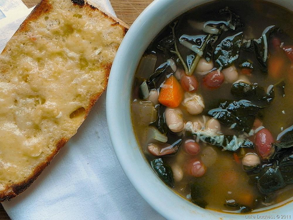 overhead image of zuppa di fagioli italian bean soup with cheese crostini