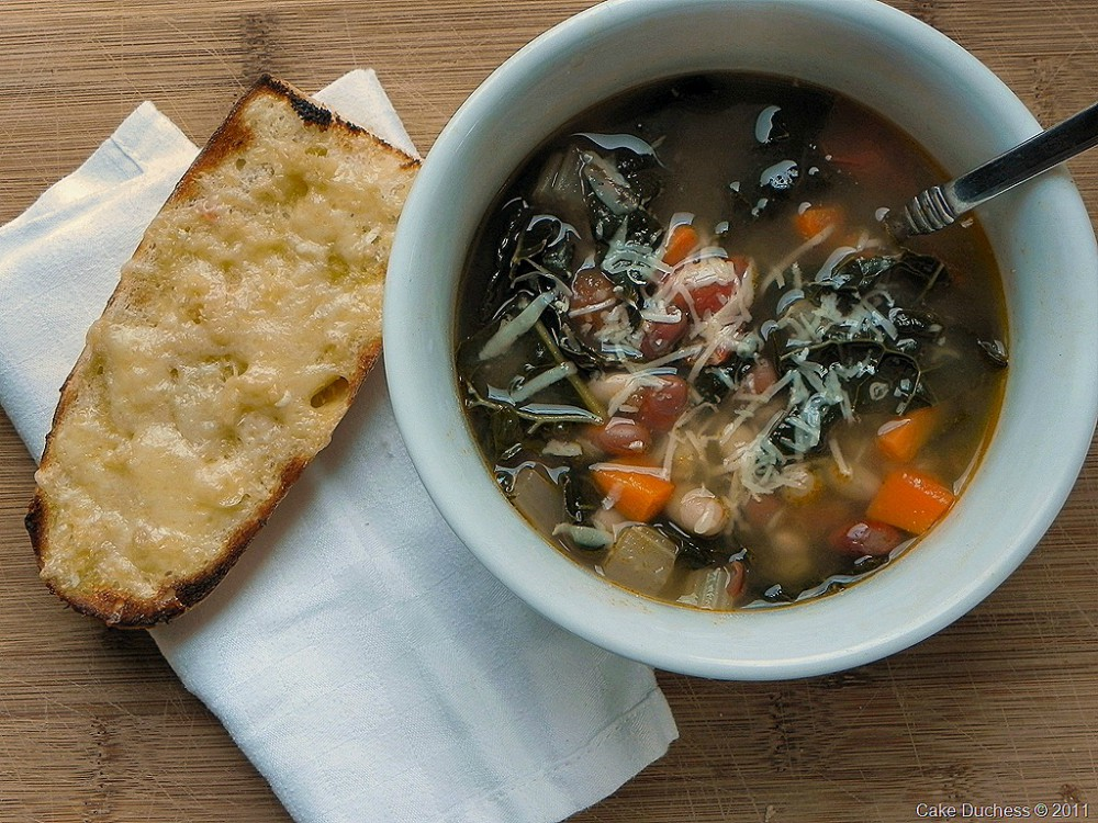 overhead image of bean soup with cheesy bread